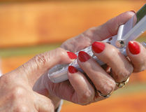 Senior communication. Close-up image of the senior woman hands using a mobile phone Royalty Free Stock Photo