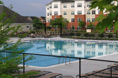 Community Pool. Senior community center with outdoor swimming pool Royalty Free Stock Images