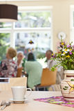 Senior Community in a retirement home. Defocused senior community in a retirement home having breakfast Stock Photo