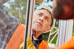 Senior competent window fitter. Assembles and modernizes new window royalty free stock images