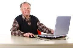 Senior with computer Royalty Free Stock Photos