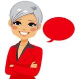Senior Confident Businesswoman. Portrait of an attractive senior confident businesswoman with red blank balloon isolated on white background stock illustration