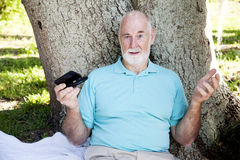 Senior Confused by Texting royalty free stock photography