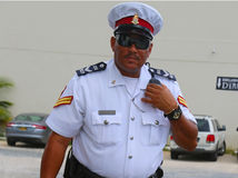 Senior constable from Royal Cayman Islands Police Service in George Town, Grand Cayman. GEORGE TOWN, GRAND CAYMAN - JUNE 12: Senior constable from Royal Cayman Stock Photos