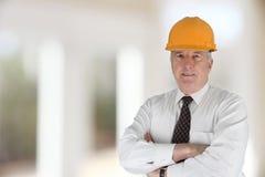 Senior Construction Foreman. Senior construction worker looking at plans on job stock photos