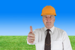 Senior Construction Foreman. Senior construction worker looking at plans on job stock photography