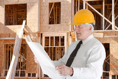 Senior Construction Foreman. Senior construction worker looking at plans on job royalty free stock photography
