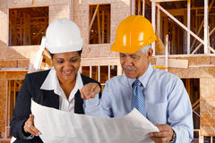 Senior Construction Foreman. Construction workers working on a job together stock images