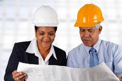 Senior Construction Foreman. Construction workers working on a job together royalty free stock photos