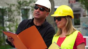 Senior construction site manager and apprentice
