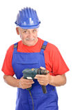 Senior constructor electric drill Royalty Free Stock Image