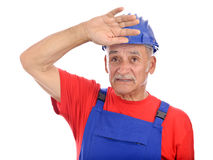 Senior constructor looking up Stock Photo