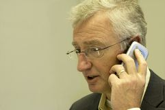 Senior Consultant Calling. Senior consultant making a business call to his boss stock photos