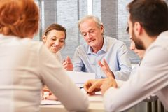 Senior consulting man with competence. Senior consulting men with competence and experience in meeting stock photo