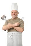 Senior cook with kitchen utensils Stock Photography