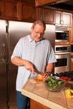 Senior cooking Stock Image
