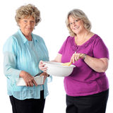 Senior Cooking Friends Stock Photography