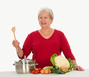 Senior is cooking Stock Photography