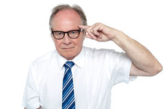 Senior corporate immersed in deep thoughts Royalty Free Stock Photo