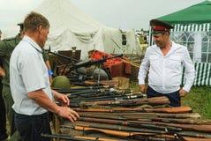 Senior cossack demonstrates rifles collection Stock Photo