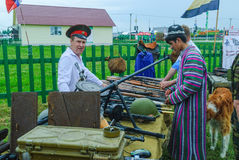 Senior cossack demonstrates rifles collection Stock Images