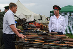 Senior cossack demonstrates rifles collection Royalty Free Stock Photo
