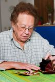 Senior counts their money from pension. Old woman counts her money Stock Photos
