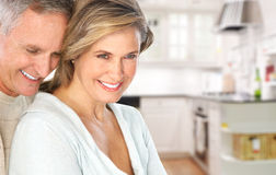 Senior couple. Smiling and happy at home stock photos