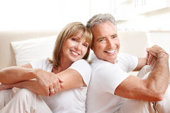 Senior couple. At home smiling and happy royalty free stock photo