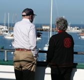 Senior Couple. Looking out at the harbor Stock Photos