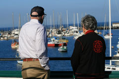 Senior Couple. Looking out at the harbor Royalty Free Stock Photo