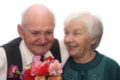 Senior couple. With bunch of flowers, isolated on white background Royalty Free Stock Photography