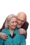Senior couple. Man embracing shoulders of his wife, isolated on white background Royalty Free Stock Image