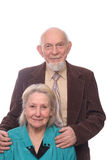 Senior couple. Man embracing shoulders of his wife, isolated on white background Stock Image