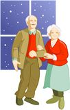 Senior couple. Old man and woman standing while is snowing through the window Stock Image