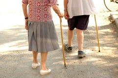 Senior couple. Detail of a senior couple walking with stick stock photo