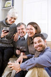Senior couple, adult children talking and drinking Royalty Free Stock Photo