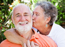 Senior Couple - Affectionate Kiss Stock Images