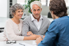 Senior couple with agent royalty free stock photo