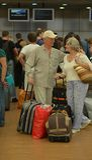 Senior couple at the airport Stock Photos