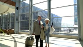 Senior couple in airport stock footage