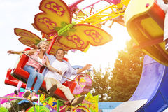 Senior couple in amusement park Royalty Free Stock Image