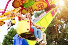 Senior couple in amusement park Stock Photos