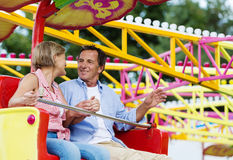 Senior couple in amusement park Stock Image