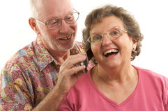 Senior Couple And Cell Phone Royalty Free Stock Photos