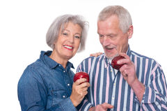 Senior couple with apple Stock Photo