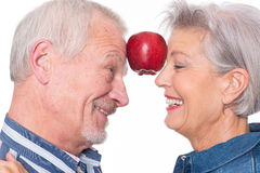 Senior couple with apple Stock Photography