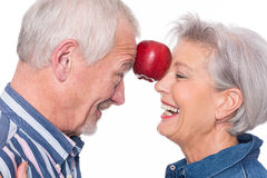 Senior couple with apple Stock Image