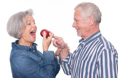 Senior couple with apple Royalty Free Stock Images