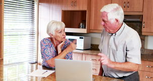 Senior couple arguing with each other in kitchen. At home stock footage
